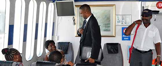 Minister Paul Lewis takes contingent to Antigua to look at the port and Ferry travel