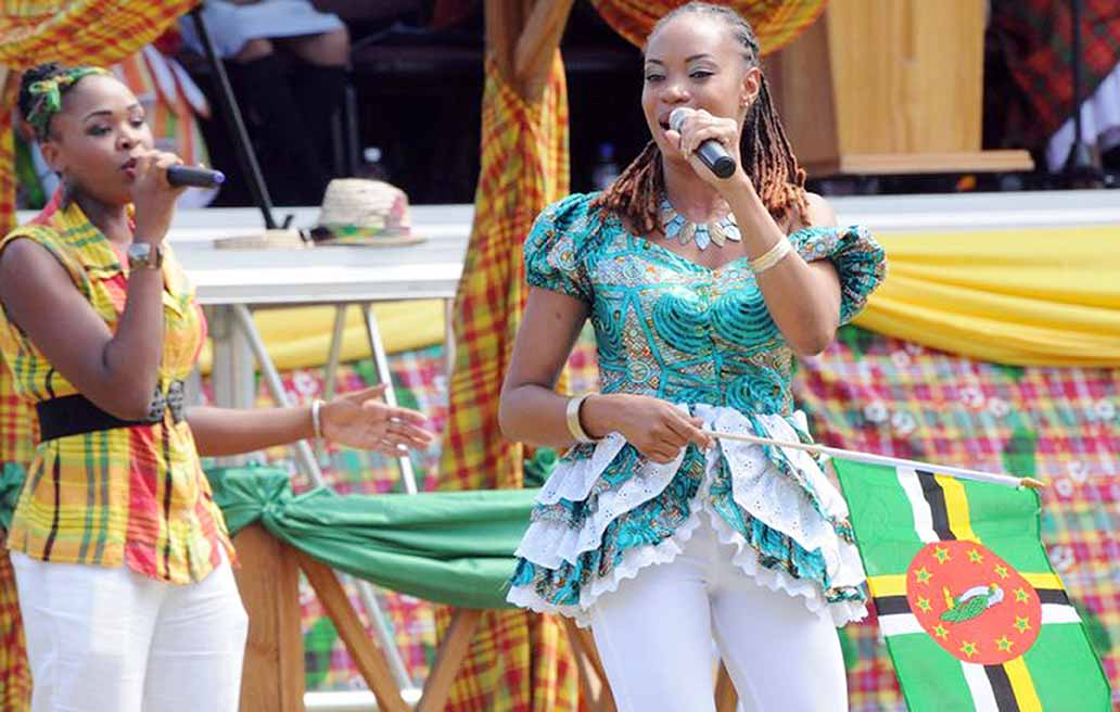 DSC_1162_Michele Henderson sings her CARICOM song and flies her Dominica flag